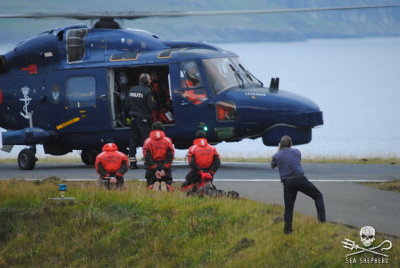 Members of the Sea Shepherd boat team are arrested and taken away by Danish Navy helicopter
