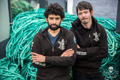The leaders of Operation Icefish, Capts. Sid Chakravarty and Peter Hammarstedt, in front of some of the 72 km of illegal gillnet abandoned by the Thunder.