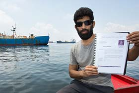 Capt. Sid Chakravarty holds the Interpol Purple Notice, issued to the Viking in 2014 for illegal fishing activities. Photo: Tim Watters
