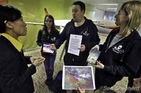Sea Shepherd Volunteers deliver a petition and letter of protest to a Hong Kong Airlines representative