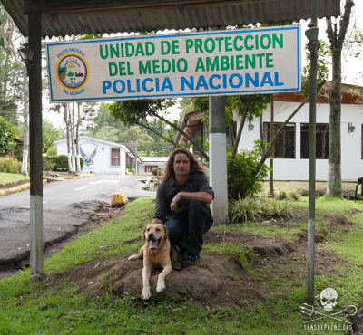 Canine Officer Manotas poses with Cove Guardian and Sea Shepherd volunteer, Erwin Vermeulen, who went to Galapagos for Manotas' retirement ceremonies. Officer Manotas was a member of the Environmental Protection Unit of the Galapagos National Police.