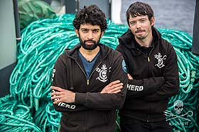 The leaders of Operation Icefish, Capts. Sid Chakravarty and Peter Hammarstedt, in front of some of the 72 km of illegal gillnet abandoned by the Thunder. Photo: Jeff Wirth