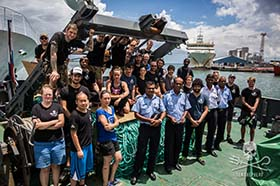 Capt. Chakravarty and the crew of the Sam Simon hand-over confiscated gillnets to police in Mauritius. Photo: Jeff Wirth