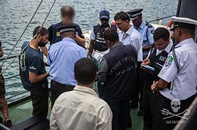 Evidence of the Thunder's illegal fishing is handed-over to Interpol and Mauritian authorities by Sea Shepherd. Photo: Jeff Wirth