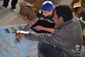 Ross McCall reviews strategy with the Operation Sleppid Grindini land team. Photo: Alexandra Bennaceur