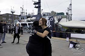 Crewmembers share goodbyes as the Sam Simon departs for Operation Sleppid Grindini. Photo: Michael Artermis