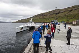 A bus-load of tourists stopped to take photographs of the Brigitte Bardot in the Faroe Islands, and to speak to their crew about the defense of pilot whales. Photo: Mayk Wendt