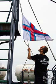 The courtesy flag is raised as the Sam Simon heads into Sund. Photo: Nik Tsoutsos