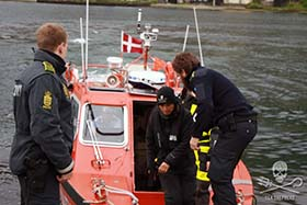 Sea Shepherd volunteer, Susan Larsen of the United States, is taken into custody. Photo: Florian Stadler