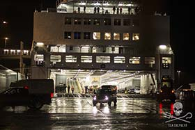 Crew being loaded onto ferry for deportation in the early hours of the morning. Photo: Mayk Wendt