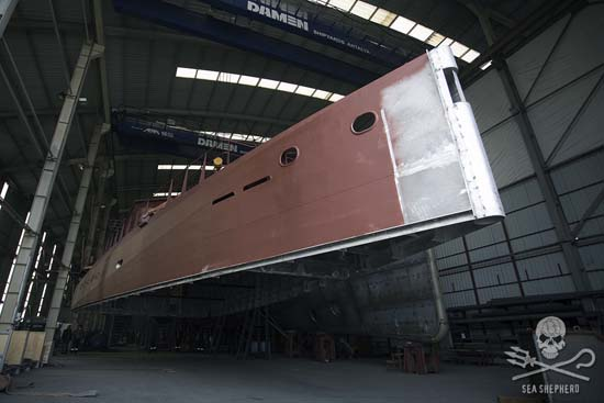 The aluminium superstructure of the new vessel is placed on top of the steel hull. Photo: Gary Stokes