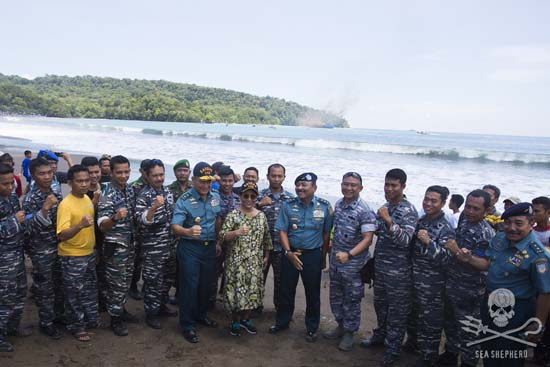 A show of strength from Fisheries Minister Susi Pudjiastuti, as the Viking sinks in the background. Photo: Gary Stokes