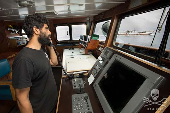 Capt. Chakravarty radios the poachers, notifying them of their illegal activity. Photo: Tim Watters