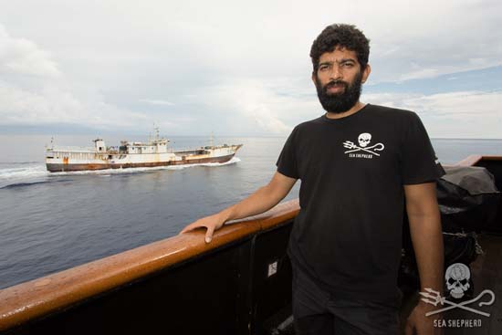 Capt. Chakravarty and the illegal fishing vessel, Fu Yuan Yu 076. Photo: Tim Watters