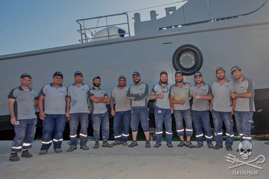 Damen crew posing proudly in front of the finished Ocean Warrior after an 18-month build.