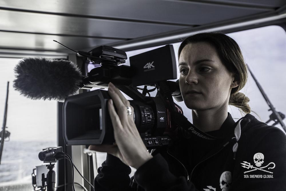 Oceaen Warrior producer/videographer Ashley shoot on the OW bridge. Photo: Sea Shepherd Global/ Simon Ager