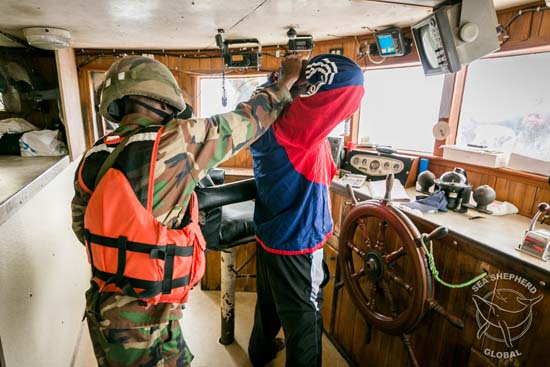 Liberian Coast Guard on the bridge of the Star Shrimper XXV. Copyright Michael Rauch/Sea Shepherd Global