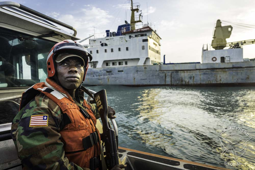 Liberian Coast Guard approaching the Reefer M/V Lian Run. Photo: Alejandra Gimeno/Sea Shepherd Global.