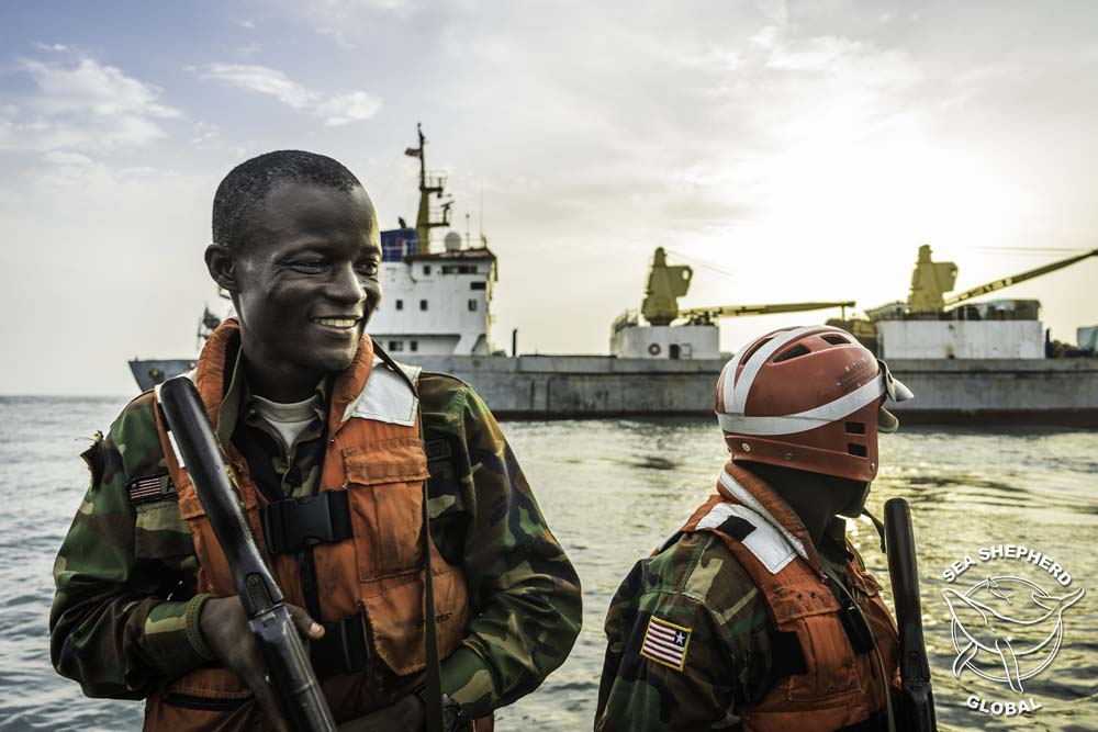Liberian Coast Guard with  M/V Lian Run  in the background. Photo: Alejandra Gimeno/Sea Shepherd Global.