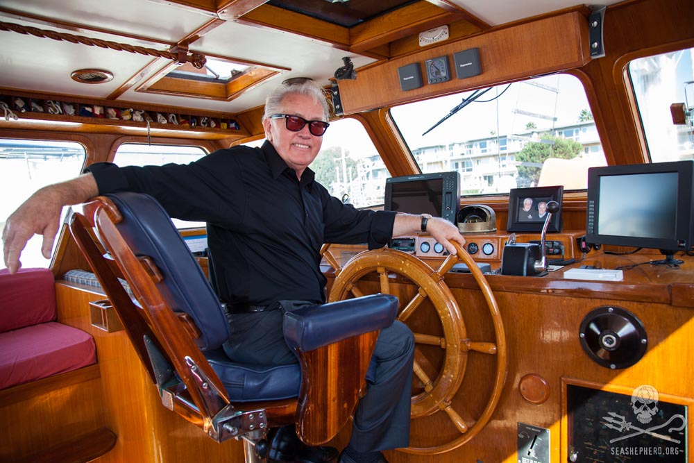 Actor Martin Sheen sitting at the helm of the R/V Martin Sheen