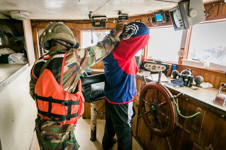 Liberian Coast Guard on the bridge of the Star Shrimper XXV. Photo by Michael Rauch/Sea Shepherd.