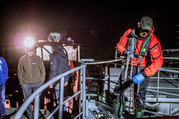 The crew is heading out to rescue the gray seal pup during the night. Photo by Sea Shepherd.