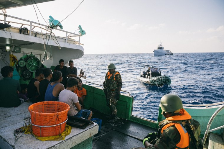 The small boat of Sea Shepherd's Ocean Warrior brings Tanzanian Marines to the Buah Naga 1 for inspection. Photo by Jax Oliver/Sea Shepherd.