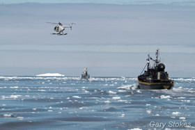 The Steve Irwin and the Nancy Burnet helicopter in pursuit of the Yushin Maru