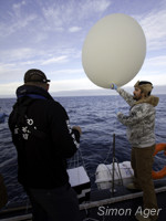 Captain Locky MacLean and crewmember Kevin McGinty launching weather balloons