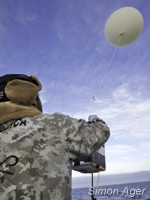 Captain Locky MacLean launches a weather balloon
