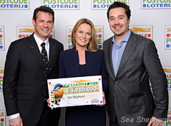SSCS CEO Steve Roest, and Dutch Board Member Laurens de Groot, receiving check from Dutch Postcode Lottery.