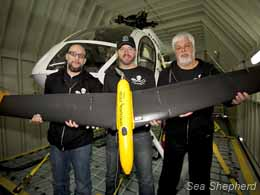 Captain Paul Watson, Sea Shepherd pilot Chris Aultman and Sea Shepherd Security Officer Jeffrey Milstein with the drone in the hanger of the Steve Irwin. Photo: Barbara Veiga