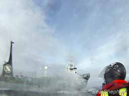 The Yushin Maru #3 sprays the Sea Shepherd small boat crew with their water cannons as they travel through French Antarctic waters. Photo: Carolina A. Castro