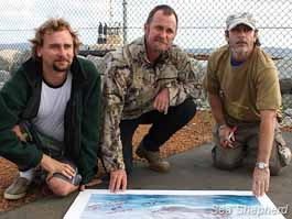 Geoffrey Tuxworth, Glen Pendlebury, and Simon Peterffy sign painting for Starlight Foundation fundraiser
