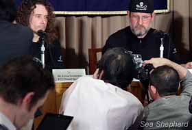 Photographers gather around Erwin and Scott at a press conference in Tokyo. Photo: Rex Ray