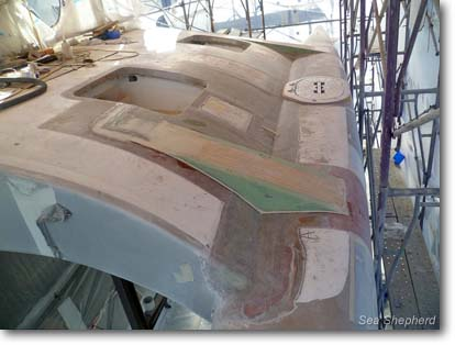 March 2, 2012: Topside of damaged wing with structural braces.