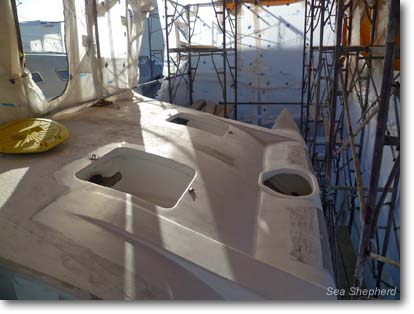 March 12, 2012: Topside of damaged wing with repair nearly completed.