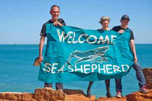 Sea Shepherd Australia director Jeff Hansen with campaign leader Bob Brown and Labor MP Melissa Parke hold a Sea Shepherd flag. Photo: Bronte Turner for the Bob Brown Foundation