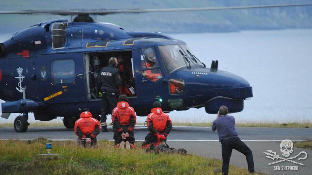Sea Shepherd boat crew are arrested and taken away by Danish Navy helicopter in 2015 [Photo: Sea Shepherd]